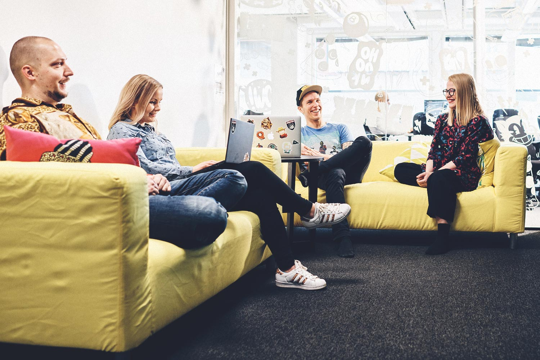 Developers brainstorming in a cozy meeting room