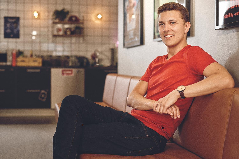 Senior Live Operations Manager sitting on a sofa at Ubisoft RedLynx game development studio in Helsinki, Finland