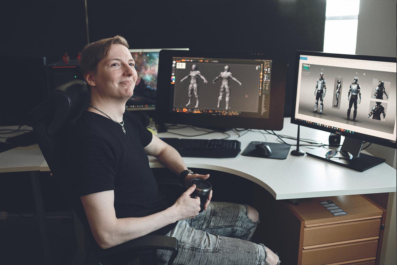 Character Artist at his desk at the Ubisoft RedLynx game development studio in Helsinki, Finland