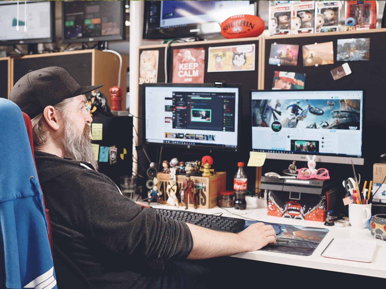 Ubisoft RedLynx game developer at his desk in Helsinki, Finland